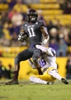 Nov 23, 2013; Baton Rouge, LA, USA; Texas A&M Aggies wide receiver Derel Walker (11) is tackled by LSU Tigers defensive back Tre'Davious White (16) in the second half at Tiger Stadium. LSU defeated Texas A&M 34-10. Mandatory Credit: Crystal LoGiudice-USA TODAY Sports