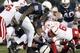 Nov 23, 2013; University Park, PA, USA; Nebraska Cornhuskers quarterback Ron Kellogg III (12) fumbles the ball during the third quarter against the Penn State Nittany Lions at Beaver Stadium. Nebraska defeated Penn State 23-20 in overtime. Mandatory Credit: Matthew O'Haren-USA TODAY Sports