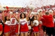 Nov 23, 2013; Fresno, CA, USA; Fresno State Bulldogs cheerleaders celebrate after the Bulldogs defeated the New Mexico Lobos to win the West Division of the Mountain West Conference at Bulldog Stadium. The Bulldogs defeated the Lobos 69-28. Mandatory Credit: Cary Edmondson-USA TODAY Sports