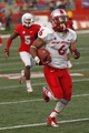 Nov 23, 2013; Fresno, CA, USA; New Mexico Lobos running back Jhurell Pressley (6) runs for a touchdown against the Fresno State Bulldogs in the fourth quarter at Bulldog Stadium. The Bulldogs defeated the Lobos 69-28. Mandatory Credit: Cary Edmondson-USA TODAY Sports