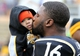 Nov 23, 2013; Hattiesburg, MS, USA; Southern Miss Golden Eagles senior defensive back Alex Smith (16) kisses his son, Jaxson Smith, before the start of their game against the Middle Tennessee Blue Raiders at M.M. Roberts Stadium. Smith's family was with him on the field while seniors were honored in pre-game ceremonies. Mandatory Credit: Chuck Cook-USA TODAY Sports