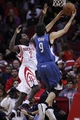 Nov 23, 2013; Houston, TX, USA; Minnesota Timberwolves point guard Ricky Rubio (9) shoots over Houston Rockets point guard Patrick Beverley (2) during the first quarter at Toyota Center. Mandatory Credit: Andrew Richardson-USA TODAY Sports