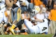 Nov 23, 2013; Knoxville, TN, USA; Tennessee Volunteers linebacker A.J. Johnson (45) tackles Vanderbilt Commodores quarterback Patton Robinette (4) during the second quarter at Neyland Stadium. Mandatory Credit: Randy Sartin-USA TODAY Sports