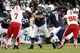 Nov 23, 2013; University Park, PA, USA; Penn State Nittany Lions guard John Urschel (64) blocks during the third quarter against the Nebraska Cornhuskers at Beaver Stadium. Nebraska defeated Penn State 23-20 in overtime. Mandatory Credit: Matthew O'Haren-USA TODAY Sports