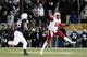 Nov 23, 2013; University Park, PA, USA; Nebraska Cornhuskers quarterback Ron Kellogg III (12) throws a pass during the fourth quarter against the Penn State Nittany Lions at Beaver Stadium. Nebraska defeated Penn State 23-20 in overtime. Mandatory Credit: Matthew O'Haren-USA TODAY Sports