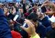 Nov 23, 2013; Tucson, AZ, USA; Arizona Wildcats running back Ka'Deem Carey (bottom left) is surrounded by fans celebrating and taking photos with their phones after defeating the Oregon Ducks at Arizona Stadium. Arizona defeated Oregon 42-16. Mandatory Credit: Mark J. Rebilas-USA TODAY Sports