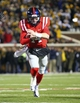 Nov 23, 2013; Oxford, MS, USA; Mississippi Rebels quarterback Bo Wallace (14) advances the ball during the game against the Missouri Tigers at Vaught-Hemingway Stadium. Mandatory Credit: Spruce Derden-USA TODAY Sports