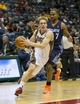 Nov 23, 2013; Milwaukee, WI, USA; Milwaukee Bucks guard Nate Wolters (6) drives for the basket in front of Charlotte Bobcats guard Ramon Sessions (7) during the fourth quarter at BMO Harris Bradley Center.  Charlotte won 96-72.  Mandatory Credit: Jeff Hanisch-USA TODAY Sports