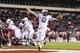 Nov 23, 2013; Philadelphia, PA, USA; Connecticut Huskies quarterback Casey Cochran (12)  scores the game tying touchdown during the fourth quarter against the Temple Owls at Lincoln Financial Field. UCONN defeated Temple 28-21. Mandatory Credit: Howard Smith-USA TODAY Sports