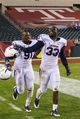 Nov 23, 2013; Philadelphia, PA, USA; Connecticut Huskies defensive end Jesse Joseph (91) and linebacker Yawin Smallwood (33) celebrate after defeating the Temple Owls at Lincoln Financial Field. UCONN defeated Temple 28-21. Mandatory Credit: Howard Smith-USA TODAY Sports