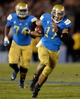 Nov 23, 2013; Pasadena, CA, USA; UCLA Bruins quarterback Brett Hundley (17) scrambles for a first down during second half action against Arizona State Sun Devils at Rose Bowl. UCLA lost 38-33. Mandatory Credit: Robert Hanashiro-USA TODAY Sports