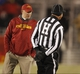 Nov 23, 2013; Ames, IA, USA; Iowa State Cyclones head coach Paul Rhoads talks to an official during the game against the Kansas Jayhawks in the third quarter at Jack Trice Stadium. Iowa State won 34-0. Mandatory Credit: Bruce Thorson-USA TODAY Sports