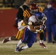 Nov 23, 2013; Ames, IA, USA; Iowa State Cyclones defender Jeremiah George (52) tackles Kansas Jayhawks running back Connor Embree (34) in the fourth quarter at Jack Trice Stadium. Iowa State won 34-0. Mandatory Credit: Bruce Thorson-USA TODAY Sports