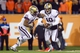 Nov 23, 2013; Corvallis, OR, USA; Washington Huskies quarterback Cyler Miles (10) fakes a hand off running back Bishop Sankey (25)  against Oregon State Beavers at Reser Stadium. Mandatory Credit: Jaime Valdez-USA TODAY Sports