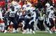 Nov 24, 2013; Kansas City, MO, USA; San Diego Chargers fullback Le'Ron McClain (33) and cornerback Johnny Patrick (26) celebrate after the game against the Kansas City Chiefs at Arrowhead Stadium. San Diego won 41-38. Mandatory Credit: John Rieger-USA TODAY Sports