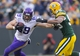Nov 24, 2013; Green Bay, WI, USA; Minnesota Vikings tight end John Carlson (89) rushes with the football as Green Bay Packers linebacker Brad Jones (59) defends during overtime at Lambeau Field.  The Vikings and Packers tied 26-26.  Mandatory Credit: Jeff Hanisch-USA TODAY Sports