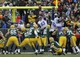 Nov 24, 2013; Green Bay, WI, USA;  Green Bay Packers kicker Mason Crosby (2) kicks a field goal against Minnesota Vikings defensive tackle Kevin Williams (93) and defensive tackle Letroy Guion (98) in overtime at Lambeau Field.  The Packers and Vikings finished in a tie 26-26. Mandatory Credit: Benny Sieu-USA TODAY Sports