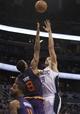 Nov 24, 2013; Orlando, FL, USA; Orlando Magic center Nikola Vucevic (9) shoots over Phoenix Suns power forward Channing Frye (8) during the second half at Amway Center. Phoenix Suns 104-96. Mandatory Credit: Kim Klement-USA TODAY Sports