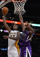 Nov 24, 2013; Los Angeles, CA, USA;   Sacramento Kings power forward Luc Richard Mbah a Moute (33) defends a shot by Los Angeles Lakers center Jordan Hill (27) go for a rebound in the first half of the game at Staples Center. Mandatory Credit: Jayne Kamin-Oncea-USA TODAY Sports