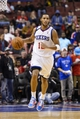 Nov 22, 2013; Philadelphia, PA, USA; Philadelphia 76ers guard Evan Turner (12) brings the ball up court during overtime against the Milwaukee Bucks at Wells Fargo Center. The Sixers defeated the Bucks 115-107 in overtime. Mandatory Credit: Howard Smith-USA TODAY Sports