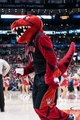 Nov 17, 2013; Toronto, Ontario, CAN; The Toronto Raptors mascot entertains the crowd during the fourth quarter of a game at the Air Canada Centre. Portland won the game 118-110. Mandatory Credit: Mark Konezny-USA TODAY Sports