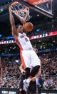 Nov 17, 2013; Toronto, Ontario, CAN; Toronto Raptors shooting guard DeMar DeRozan (10) dunks during the fourth quarter of a game against the Portland Trail Blazers at the Air Canada Centre. Portland won the game 118-110. Mandatory Credit: Mark Konezny-USA TODAY Sports