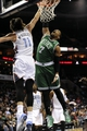 Nov 25, 2013; Charlotte, NC, USA; Boston Celtics forward Jared Sullinger (7) drives to the basket as he is defended by Charlotte Bobcats forward Josh McRoberts (11) during the first half of the game at Time Warner Cable Arena. Mandatory Credit: Sam Sharpe-USA TODAY Sports