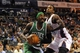 Nov 25, 2013; Charlotte, NC, USA; Boston Celtics forward Gerald Wallace (45) drives past Charlotte Bobcats forward Michael Kidd-Gilchrist (14) during the first half of the game at Time Warner Cable Arena. Mandatory Credit: Sam Sharpe-USA TODAY Sports