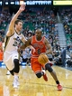 Nov 25, 2013; Salt Lake City, UT, USA; Chicago Bulls point guard Mike James (8) attempts to dribble around Utah Jazz shooting guard Gordon Hayward (20) during the first half against the Utah Jazz at EnergySolutions Arena. Mandatory Credit: Russ Isabella-USA TODAY Sports
