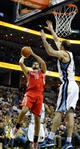 Nov 25, 2013; Memphis, TN, USA; Houston Rockets small forward Omri Casspi (18) shoots the ball over Memphis Grizzlies center Kosta Koufos (41) during the fourth quarter at FedExForum. Houston Rockets beat the Memphis Grizzlies 93-86. Mandatory Credit: Justin Ford-USA TODAY Sports