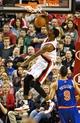 Nov 25, 2013; Portland, OR, USA; Portland Trail Blazers small forward Dorell Wright (1) dunks over New York Knicks point guard Pablo Prigioni (9) at the Moda Center. Mandatory Credit: Craig Mitchelldyer-USA TODAY Sports