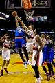 Nov 25, 2013; Portland, OR, USA; New York Knicks shooting guard J.R. Smith (8) and Portland Trail Blazers center Robin Lopez (42) fight for a rebound at the Moda Center. Mandatory Credit: Craig Mitchelldyer-USA TODAY Sports
