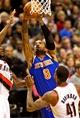Nov 25, 2013; Portland, OR, USA; New York Knicks shooting guard J.R. Smith (8) shoots over Portland Trail Blazers power forward Thomas Robinson (41) at the Moda Center. Mandatory Credit: Craig Mitchelldyer-USA TODAY Sports
