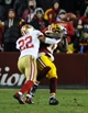 Nov 25, 2013; Landover, MD, USA; San Francisco 49ers cornerback Carlos Rogers (22) breaks up a pass intended for Washington Redskins wide receiver Aldrick Robinson (11) during the second half at FedEx Field. The 49ers won 27-6. Mandatory Credit: Brad Mills-USA TODAY Sports