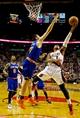 Nov 25, 2013; Portland, OR, USA; Portland Trail Blazers point guard Damian Lillard (0) shots over New York Knicks power forward Andrea Bargnani (77) at the Moda Center. Mandatory Credit: Craig Mitchelldyer-USA TODAY Sports
