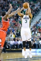 Nov 25, 2013; Salt Lake City, UT, USA; Utah Jazz point guard Trey Burke (3) shoots over Chicago Bulls point guard Marquis Teague (25) during the second half at EnergySolutions Arena. The Jazz won 89-83 in overtime. Mandatory Credit: Russ Isabella-USA TODAY Sports