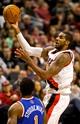 Nov 25, 2013; Portland, OR, USA; Portland Trail Blazers power forward LaMarcus Aldridge (12) shoots over New York Knicks power forward Amar'e Stoudemire (1) at the Moda Center. Mandatory Credit: Craig Mitchelldyer-USA TODAY Sports