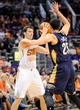Nov 10, 2013; Phoenix, AZ, USA; Phoenix Suns point guard Goran Dragic (1) prepares to pass as he is defended by New Orleans Pelicans shooting guard Austin Rivers (25) during the second quarter at US Airways Center. The Suns beat the Pelicans 101-94. Mandatory Credit: Casey Sapio-USA TODAY Sports