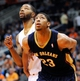 Nov 10, 2013; Phoenix, AZ, USA; New Orleans Pelicans power forward Anthony Davis (23) and Phoenix Suns power forward Marcus Morris (15) battle for positioning during a free throw attempt during the second quarter at US Airways Center. The Suns beat the Pelicans 101-94. Mandatory Credit: Casey Sapio-USA TODAY Sports