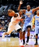 Nov 8, 2013; Phoenix, AZ, USA; Phoenix Suns point guard Eric Bledsoe (2) drives to the basket as he is defended by Denver Nuggets power forward Darrell Arthur (00) during the third quarter at US Airways Center. Mandatory Credit: Casey Sapio-USA TODAY Sports