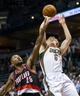 Nov 20, 2013; Milwaukee, WI, USA; Milwaukee Bucks guard Nate Wolters (6) shoots against Portland Trail Blazers guard Mo Williams (25)  during the game at BMO Harris Bradley Center.  Portland won 91-82.  Mandatory Credit: Jeff Hanisch-USA TODAY Sports