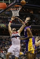 Nov 26, 2013; Washington, DC, USA; Washington Wizards center Marcin Gortat (4) shoots the ball as Los Angeles Lakers power forward Shawne Williams (3) defends in the second quarter at Verizon Center. Mandatory Credit: Geoff Burke-USA TODAY Sports