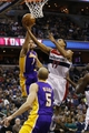 Nov 26, 2013; Washington, DC, USA; Washington Wizards shooting guard Garrett Temple (17) shoots the ball as Los Angeles Lakers point guard Jordan Farmar (1) defends in the second quarter at Verizon Center. Mandatory Credit: Geoff Burke-USA TODAY Sports
