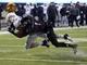 Nov 26, 2013; DeKalb, IL, USA; Western Michigan Broncos linebacker Lucas Cherocci (46) makes a catch against Northern Illinois Huskies safety Dechane Durante (1) during the second quarter at Huskie Stadium. Mandatory Credit: Mike DiNovo-USA TODAY Sports