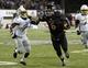Nov 26, 2013; DeKalb, IL, USA; Northern Illinois Huskies quarterback Jordan Lynch (6) rushes for a touchdown against Western Michigan Broncos cornerback Ronald Zamort (7) during the second quarter at Huskie Stadium. Mandatory Credit: Mike DiNovo-USA TODAY Sports