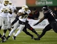 Nov 26, 2013; DeKalb, IL, USA; Western Michigan Broncos running back Dareyon Chance (22) rushes the ball against Northern Illinois Huskies linebacker Jamaal Payton (33) during the third quarter at Huskie Stadium. Mandatory Credit: Mike DiNovo-USA TODAY Sports