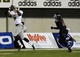 Nov 26, 2013; DeKalb, IL, USA; Western Michigan Broncos wide receiver Timmy Keith (5) makes a catch against Northern Illinois Huskies cornerback Marlon Moore (21) during the third quarter at Huskie Stadium. Mandatory Credit: Mike DiNovo-USA TODAY Sports