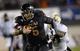 Nov 26, 2013; DeKalb, IL, USA; Northern Illinois Huskies quarterback Jordan Lynch (6) breaks the tackle of Western Michigan Broncos cornerback Ronald Zamort (7) to score his third touchdown during the third quarter at Huskie Stadium. Mandatory Credit: Mike DiNovo-USA TODAY Sports