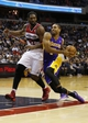 Nov 26, 2013; Washington, DC, USA; Los Angeles Lakers small forward Xavier Henry (7) dribbles the ball around Washington Wizards power forward Nene Hilario (42) in the fourth quarter at Verizon Center. The Wizards won 116-111. Mandatory Credit: Geoff Burke-USA TODAY Sports