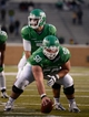 Nov 23, 2013; Denton, TX, USA; North Texas Mean Green offensive linesman Kaydon Kirby (50) and quarterback Derek Thompson (7) during the game against the UTSA Roadrunners at Apogee Stadium. The Roadrunners defeated the Mean Green 21-13. Mandatory Credit: Jerome Miron-USA TODAY Sports
